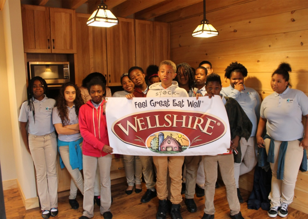Wellshire Donates to Hope Partnership for Education